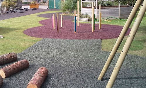 coloured rubber mulch on grass