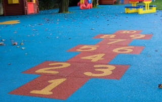 Red hopscotch in blue surfacing