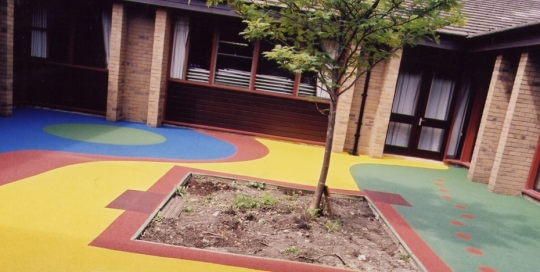 multicoloured play area surfacing - soft safety surface