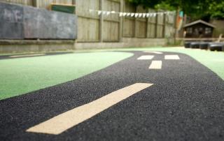 green nursery flooring with road design