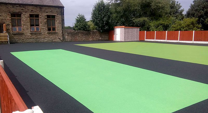 Green and black rubber play flooring