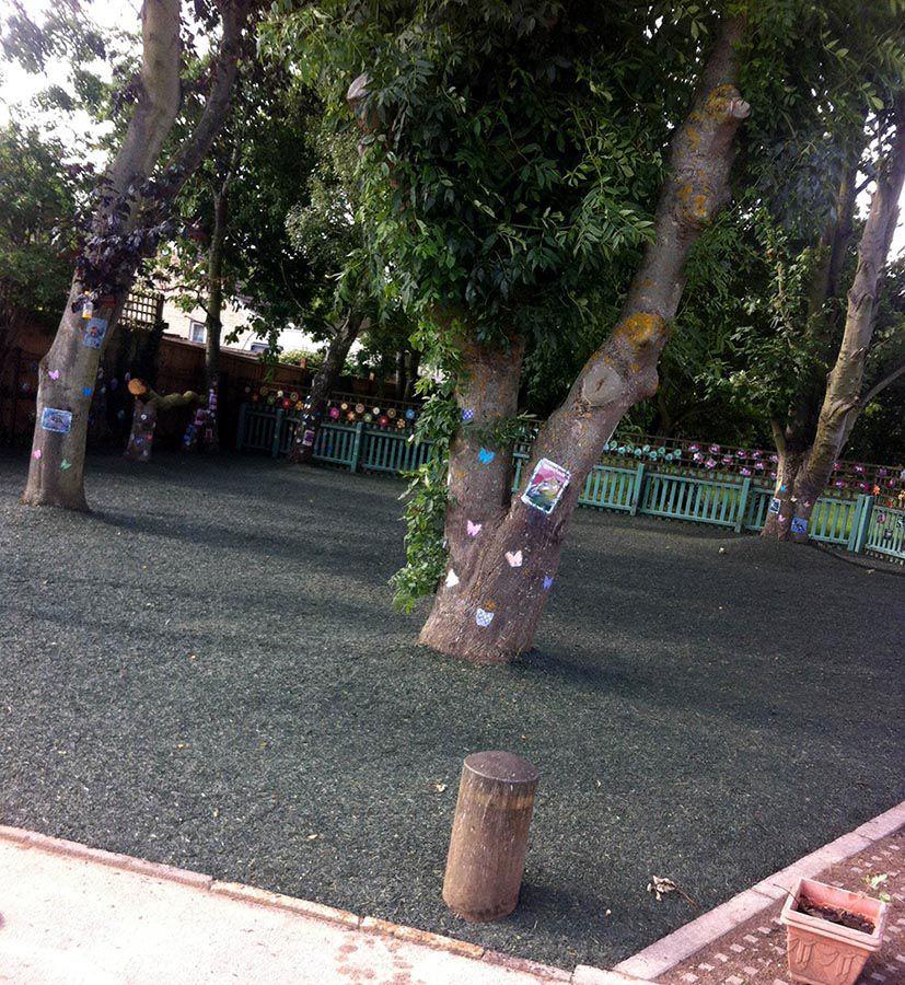 Rubber-mulch-installed-under-trees-in-nursery-playground
