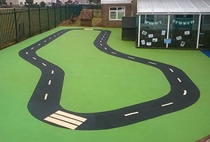 Roadway design in playground flooring