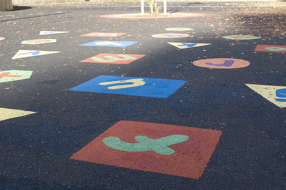 Letters and shapes in playground flooring